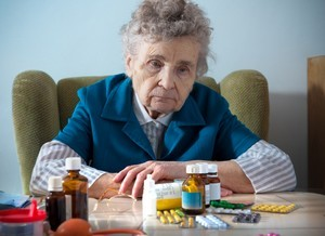 Senior-Elderly-Woman-Drugs-Prescription-Pills-Sad.jpg